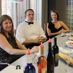 Liz and Brittany enjoy the office wine tasting despite Preston's skepticism.