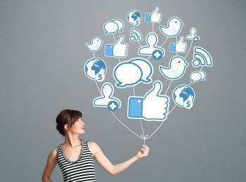 Image of woman hold social media icons